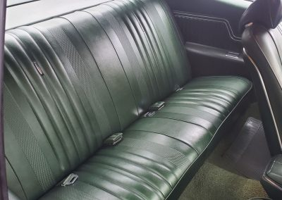 backseat 1970 Chevelle in forest green metallic at Old Town Automobile