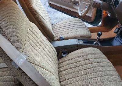 front seat 1977 Oldsmobile Cutlass in medium green at Old Town Automobile