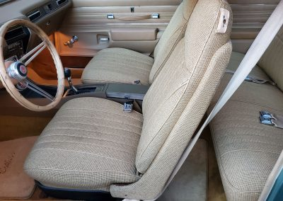 interior 1977 Oldsmobile Cutlass in medium green at Old Town Automobile