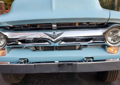 underneath 1956 Ford F100 Pickup in light blue